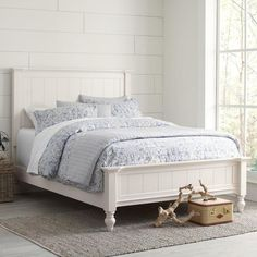 Caleb Panel Bed | With thick outer posts, clean lines, and top panels that extend to the floor, the Caleb Bed blends traditional inspiration with soft, cottage-chic styling. Crafted of Appalachian hardwoods, this versatile piece offers a welcoming backdrop for a variety of bedding designs.