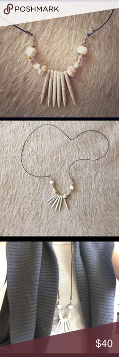 Bone colored spike tasseled necklace This is super cool. Can be dressed tribal, boho, or trendy depending on how it is worn. Right now, I left the back at this height, but if you'd want a clasp and optional height levels, I can do this for $5 extra dollars. One of a kind necklace with unique beading. Hope you love! Bundle to save. 20% off on etsy. Free People Jewelry Necklaces