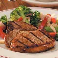 "Tangy Grilled Pork Chops Recipe -""My sister gave me the recipe for this easy five-ingredient marinade,"" writes Bernice Germann of Napoleon, Ohio. ""It keeps the meat so moist and tasty...now it's the only way my husband wants his pork chops prepared."""