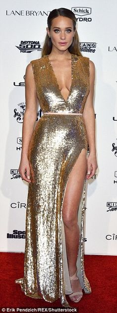 Golden girl! Hannah Davis dazzled in a plunging gold sequin dress with a pair of nude sand...