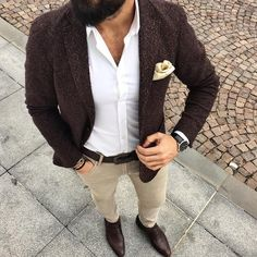 Stand out among other stylish civilians in a dark brown wool sportcoat and cream skinny jeans. Finish off this look with dark brown leather loafers. Shop this look on Lookastic: https://lookastic.com/men/looks/blazer-dress-shirt-skinny-jeans/24067 — White Dress Shirt — Tan Pocket Square — Dark Brown Wool Blazer — Black Leather Watch — Dark Brown Leather Belt — Tan Bracelet — Beige Skinny Jeans — Dark Brown Leather Loafers