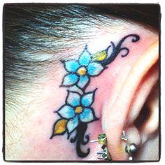 Behind the ear flower tattoo