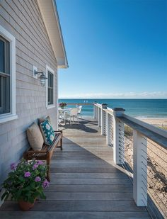 What a great beach setting this is. I can imagine sitting having breakfast with the sounds of the waves lapping against the beach in this Rhode Island beach house. Proud dad and proud home owner.