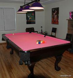 Pink felt on a classic billiard table, looks great.