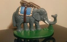 1922 CAST IRON DOORSTOP ELEPHANT w/ BLANKET AND RIDER BASKET BOOKEND