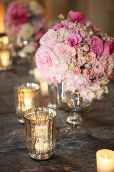 A mound of pink on pink and flickering candles at every table ~ lovely!