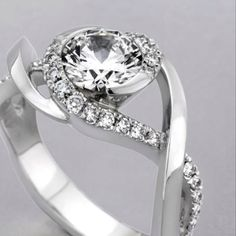 This is Awesome!  I want a unique band like this, with a princess-cut diamond of course!!! :o)