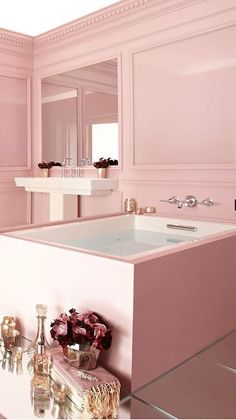 A bright pastel pink wall with striking fuschia and gold elements in this bathroom evoke a simple luxury #bathroom #oasis