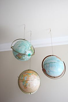 Hanging globes! I love this in 50 different ways. Oh the irony of pinning a photo from a follow-up post of a pinterest challenge.