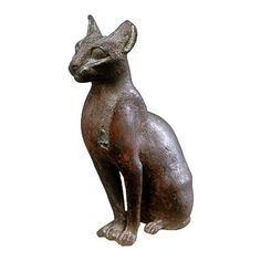 Egyptian Museum - Statue of The Cat Goddess Bastet  -  Among the animals that the ancient Egyptians respected and venerated, was the cat. They called it Bastet and its main cult center was at Bubastis (modern Zagazig in the eastern part of the Nile Delta). The cat was also the patron deity of the Memphite necropolis at Saqqara, and a great temple and underground mausoleum for cats was excavated at the edge of the necropolis.