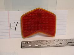 "1940 Ford 4 1/4"" wide X 3"" @ cheveron red tail light lens #22 Stamsonite front $10.00"