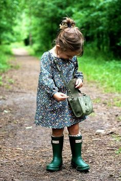 Little girl outfit: long sleeve flower dress and green Hunter boots.