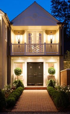 Very nice change in railing detail. Colonial look. Also nice outdoor lighting.