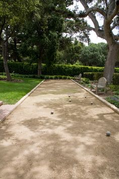 Decomposed Granite (DG) surface is great for Bocce Ball courts.  A pale stone border, goes with the DG.