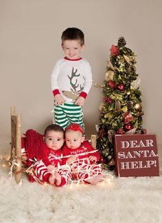 Older sibling with baby twins Christmas photo. credit: Ashley Blair Photography