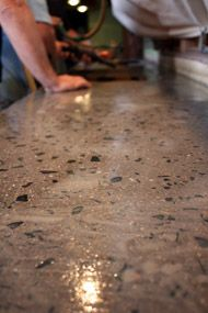 concrete countertop with glass - like the spacing of the glass