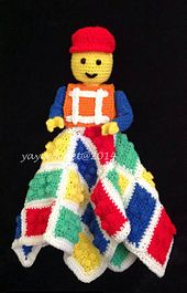 """This is an adorable and clever """"lovey"""" blanket for your child to play or sleep with. It uses brightly colored yarns in small amounts so you can use up leftover yarn from other projects."""