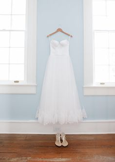 There's a reason on-hanger shots are so popular! The styled pictures evoke the calm before the storm and don't let anything compete with the dress.