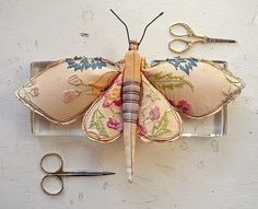 moths made from remnants of vintage embroidered linens ... gorgeous ... i want one .... sold @ http://www.etsy.com/shop/MisterFinch?ref=seller_info