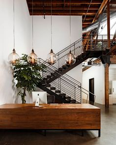 Industrial design for loft or startup office. Features external brick walls in mix with wooden frames and clear glass walls.