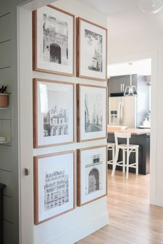 How to create a symmetrical gallery wall in a hallway with light walnut frames from PosterJack. A floor to ceiling gallery wall that makes a real statement with black and white photos. Home Living Room, Apartment Living, Living Room Decor, Living Spaces, Home Design, Interior Design, Home Fashion, Home Decor Inspiration, Home Projects