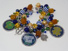 Handmade Notre Dame Charm Bracelet: Chunky Cluster Bracelet with various Navy, Gold, and Green beads by RoyalStreetBoutique on Etsy
