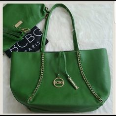 """BCBG PARIS TOTE SET Brand new with tags. Set of tote & cross body bag. Dust bag included. Green & black. Cross body has top zip closure, one zipper pocket & 2 slide pockets inside. Body: 100% Polyurethane  Lining: 100% polyester..  Tote dimension: 11.5""""H x 18.5"""" W x 4"""" D. Cross body: 9"""" x 14.5"""" x 4.5"""".  OFFERS ARE WELCOME.❌NO TRADES❌ BCBG PARIS Bags Totes"""