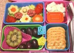 Clockwise from the top: Flower Garden (Tomato, Egg, Carrot, Cucumber, Cheese and Hot Dog all cut into flower shapes); Tofu with Soy Sauce; Crackers; Grapes & Kiwi.