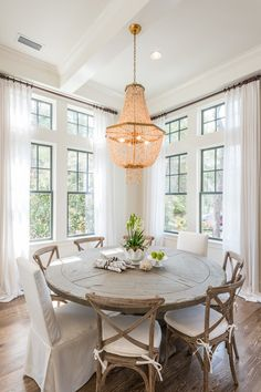 Wood Round Dining Room Table Eclectic Home tour Seaside Retreat Cross Back Dining Chairs, Round Table And Chairs, Round Tables, Farmhouse Round Dining Table, White Round Dining Table, Round Wood Kitchen Table, Circle Dining Table, Rustic Kitchen, Rustic Round Table
