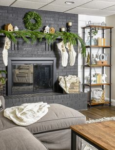 Neutral decor and fresh greenery make a beautiful combination for the perfect modern farmhouse Christmas mantel. #Christmas #holidaymantel #modernfarmhouse