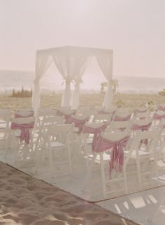 #beachwedding ceremony chairs wrapped with pashminas  Photography by Elizabeth Messina / elizabethmessina.com/, Event Design and Planning by Bluebell Events / bluebellevents.com/