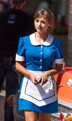 Order up! Jenna Coleman was dressed in a waitress costume for her role as Clara Oswald as Doctor Who shot scenes for the ninth series at Ed's Easy Diner in Cardiff Bay on Monday Doctor Who Film, Eleventh Doctor, Doctor Who Jenna Coleman, Waitress Outfit, Film Doctors, Doctor Who Companions, Georgia May Jagger, Maid Uniform, Hotel Uniform