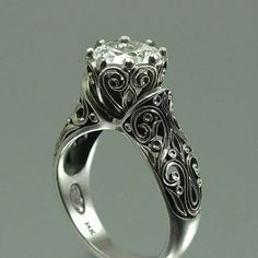 from weddings and things, I love this ring, I would wear it as an everyday ring not just a wedding ring. Do wish it was a little lower profile though.