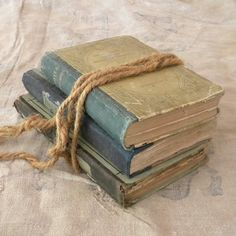 A stack of books including a bible or maybe all bibles with a ribbon hanging out of one with a dove on the end of the ribbon. Old Books, Antique Books, I Love Books, Books To Read, French Country Crafts, Have Courage And Be Kind, Store Displays, Book Nooks, Book Collection