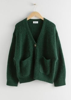 Boxy alpaca wool blend cardigan featuring duo patch pockets, three button closures and a ribbed knit finish.Length of cardigan: / (size S)Model wears: S Mode Outfits, Winter Outfits, Fashion Outfits, Fashion Fashion, 2000s Fashion, Green Fashion, Summer Outfits, Vintage Fashion, Cardigan Vert