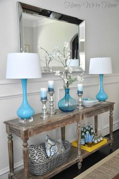 Dining Room Decor Updates // World Market Everett Foyer Table.... really like the pop of color the lamps give... and mixing the glass vase in almost the same shape, very cool