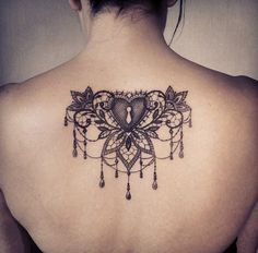 Beautiful lace and jewel tattoo-cool placement too