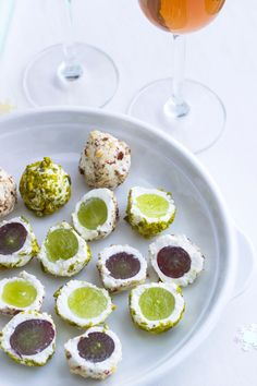 last minute healthy appetizer Goat Cheese Grape Balls  A bunch of your favorite grapes (red, green or seedless) 1lb (450g) of soft goat cheese 1/3 cup of shelled hazelnuts + 1/3 cup shelled pistachios A jar of liquid honey