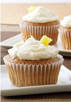 Cute Carrot Cupcakes – Make the best cream cheese frosting for this cupcake recipe and top with pineapple!