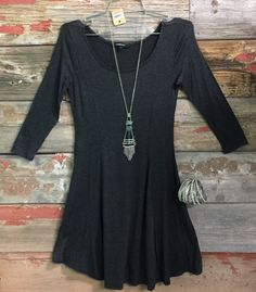We Both Know Tunic Dress in Charcoal is just that simple perfect style! Perfect for transition to fall and can be worn with leggings or as a dress. This dress is pure perfection! Sizing: Small: 0-3 Me