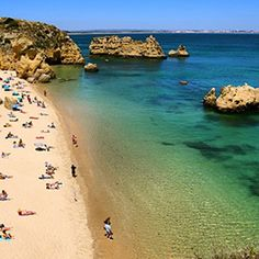 Praia Dona Ana, Portugal. Via T+L (www.travelandleisure.com).