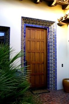 Decorate the doorway surround. Set off your front door and give it greater presence by adding a decorative frame. If the architecture will accommodate such a treatment, line it with decorative tiles or a mosaic. If not, you can achieve a similar effect with paint.