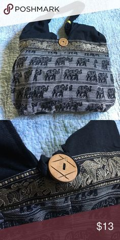 Elephant hobo style bag Black and gold fabric make this a striking find. Unique unstructured bag to go with your casual bohemian vibe. Bag has large button detail, one inside pocket, zip closure. Bags Hobos