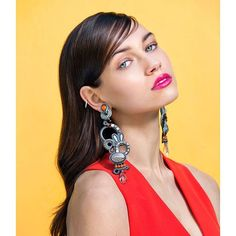 One sure fire way to add sass to an outfit is a pop of red! ~ as seen in The Atlas magazine  #DoriCsengeri #fashionmagazine #statementearrings #popofred #red #longearrings #shoulderdusters #earrings #fashionaccessories