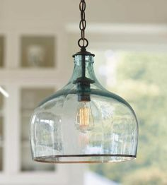 I love this light - would be great for the studio or to have three of these over the kitchen counter.  Recreate with large wine jugs and one of these type of light bulbs from your local hardware store or lighting place.  You would need an electrician to wire it into the ceiling though (unless you already have the electrical attachment and it needs just the bulb and light fixture).  This would look lovely in a smokey grey or brown colour too, depending on your kitchen colours.