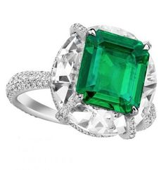 High Jewellery emerald and diamond ring by Boghossian. The verdant green 2.57 carat emerald has been set on a 7.15 carat round-cut diamond using the Kissing Gems technique, creating an effect that radiates a high-voltage display of colour and ligh