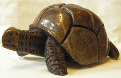 Hand Carved Soapstone Sculpture of African Tortoise  Height - 15cm  Weight - 7kg (when packaged)  This items was purchased in Swaziland in support of Aids victims.