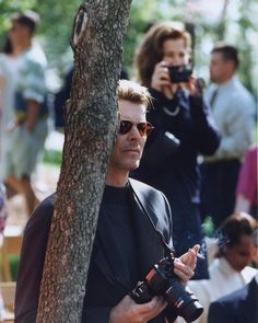 "dillybcys: ""David Bowie taking photos of his son's graduation at the College of Wooster in Wooster, OH (1995) """