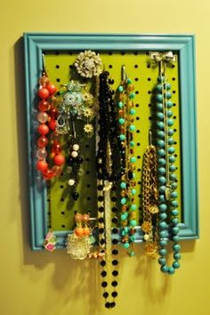 jewelry pegboard- i so want to make this and hang up my stuff in our next house. that way i can find it all, and mal can quit dumping it all out on the floor!