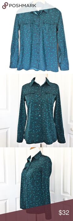 """Banana Republic Button-Up Adorable button up by Banana Republic.  Top is navy bluish in color with an all over teal blue star print.  Top is 109% polyester.  Measurements laid flat: bust 18.5"""" and length from top of shoulder to hem 25"""".  EUC!! Banana Republic Tops Button Down Shirts"""
